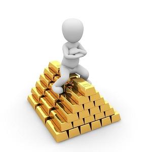 man sitting on a pile og gold