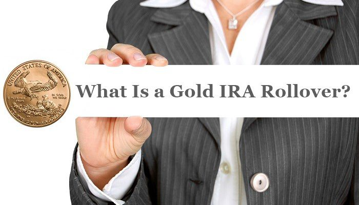 Woman holding a sign with a gold coin and the word what is a gold ira rollover