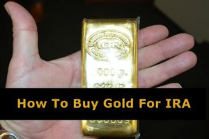 Man holding a gold bar in hand